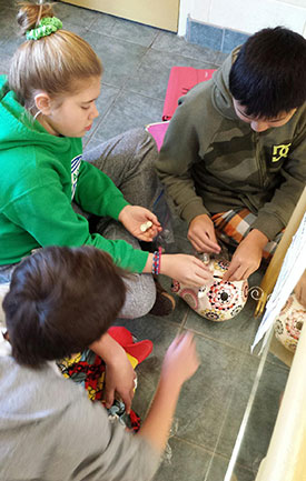 Children in pajamas counting coins