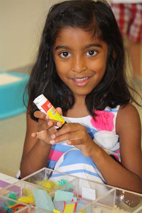 Child with glue stick